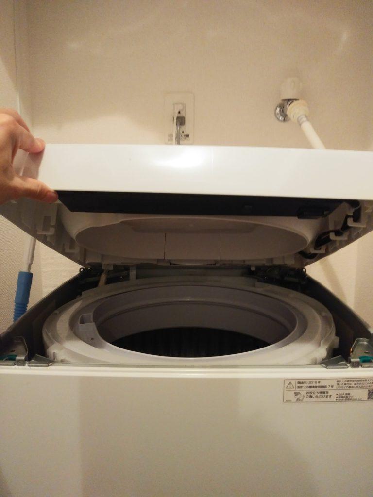 E21 洗濯機上部をもちあげ